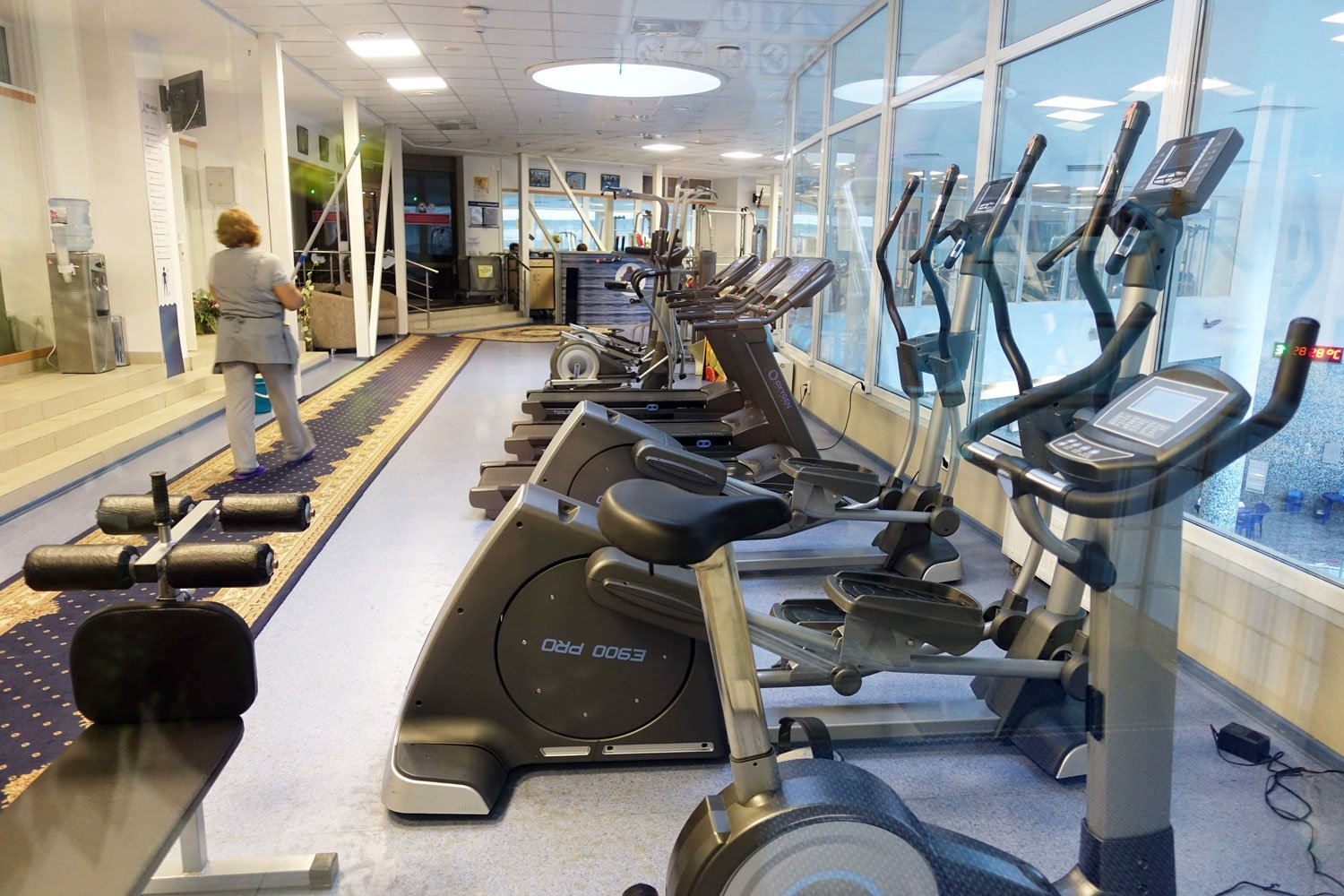 hotel belarus gym with 2 elipticals, an exercise bike, several treadmills, and weights. Good quality equipment.