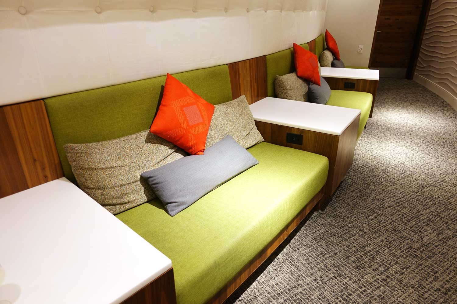 A row of sofas with throw pillows