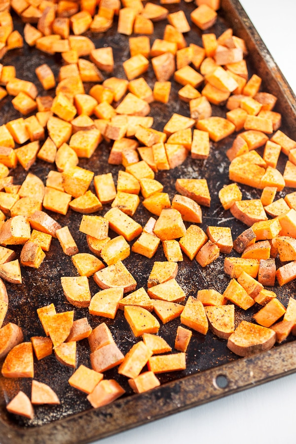 diced sweet potatoes with spices on pan