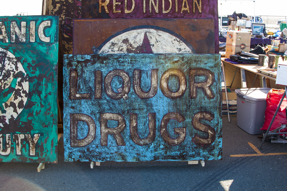 "Liquor drugs. This booth had a lot of racy art! This was a ""PG-rated"" piece in comparison to the rest."