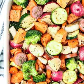 veggies with prepared with herbs ready to roast in the oven