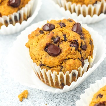 Gluten free pumpkin muffins in muffin liners.