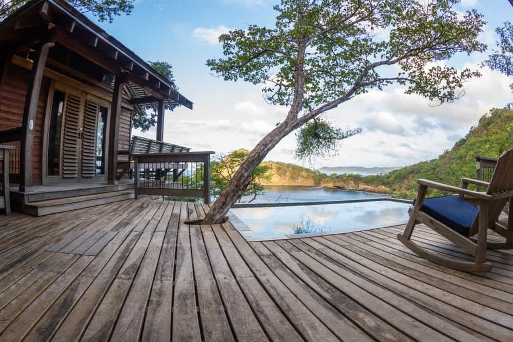 deck around tree with pool