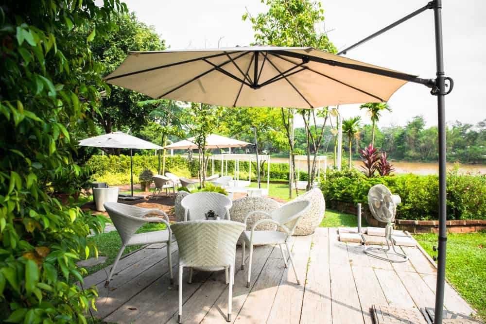 wicker chairs and umbrella
