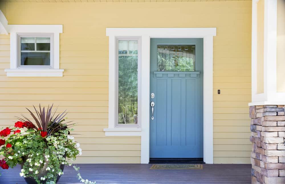 blue door cream siding