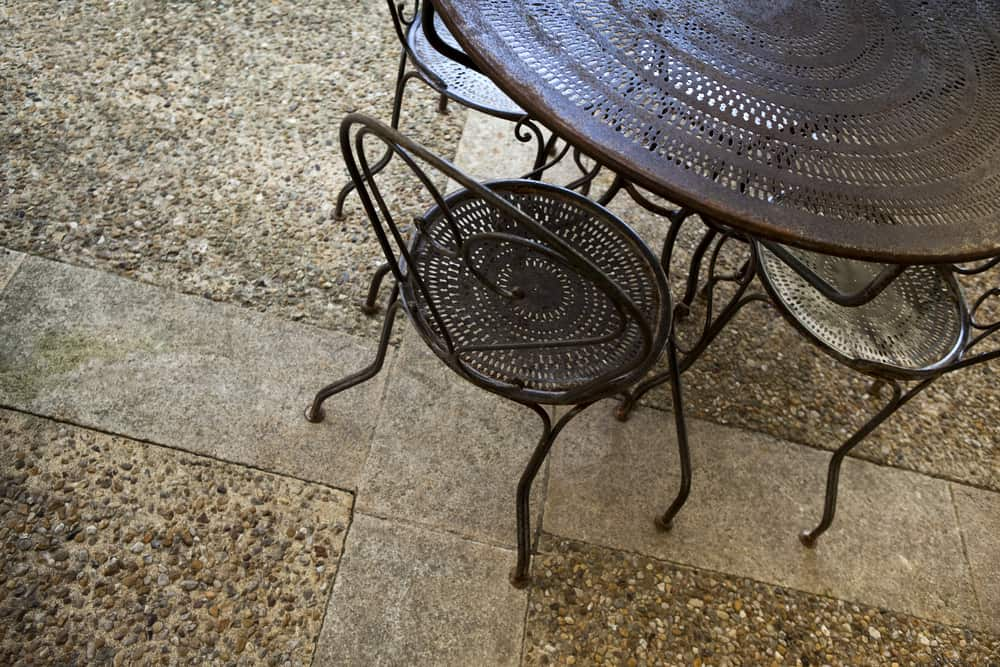 metalwork seating and stone flooring