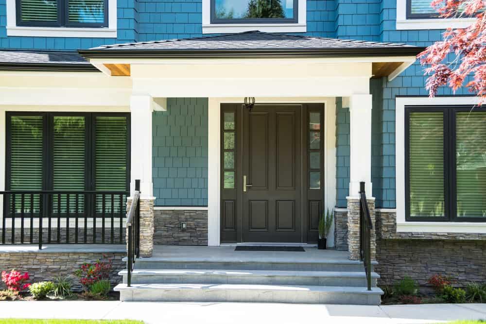 wide stairs black door blue