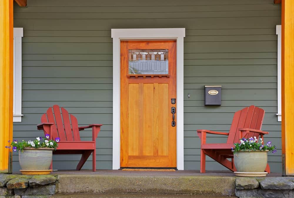 red chairs cement wood door