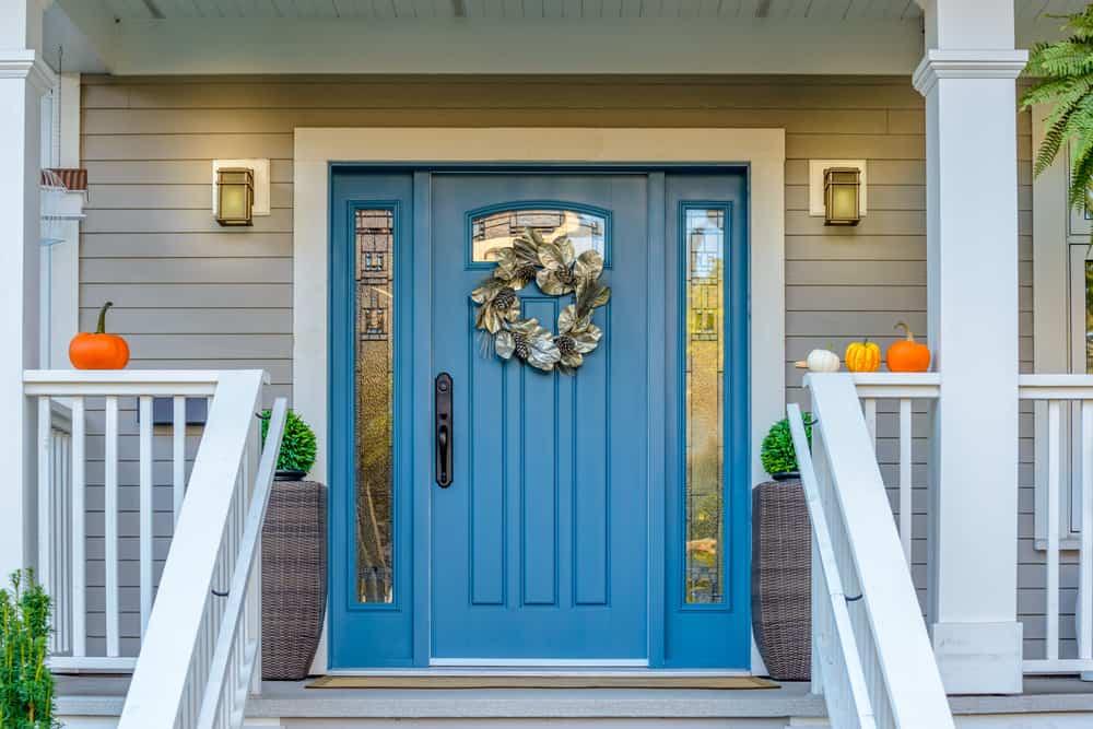 blue door with wreath