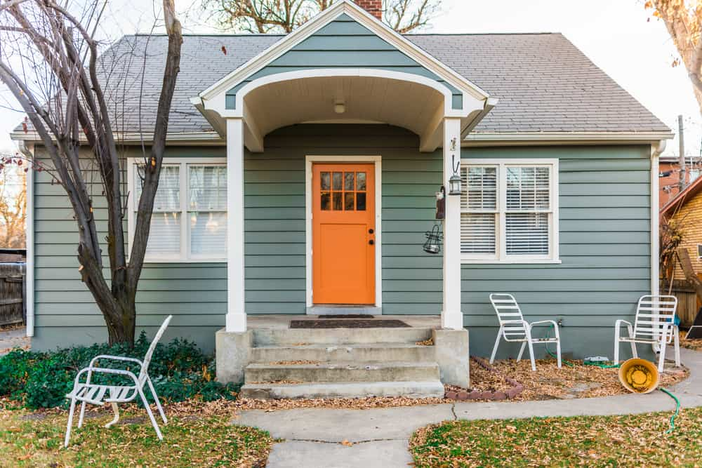 orange door grey blue siding