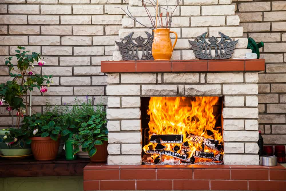 white brick wood mantle fireplace