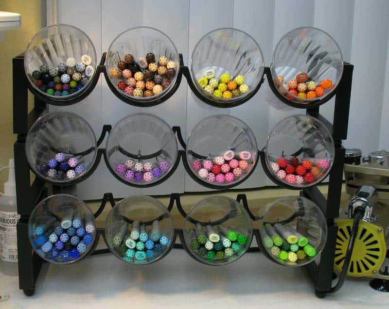 Wine Rack Storage This is a project I wish I had thought of sooner! You can make a DIY Wine Rack Organizer with a wine rack and plastic cups in no time at all! This is a terrific way to store markers, pencils, and other craft supplies. thesawguy.com