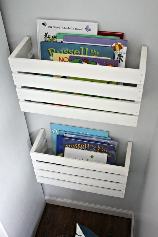 Book Storage Solutions If you have kids you understand how many books they can accumulate. This book storage idea is made by using a crate that has been painted and adhered to the wall. This is a brilliant solution that looks incredible too. thesawguy.com
