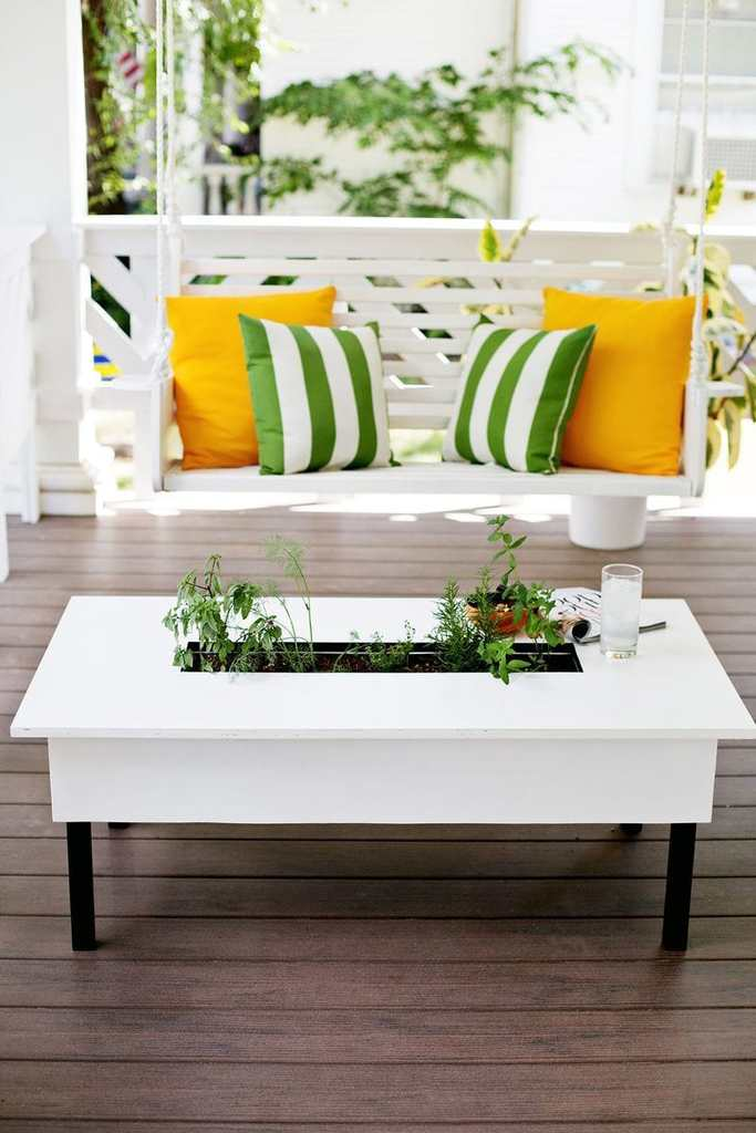 DIY Coffee Table With Herb Garden Your friends and family will be envious when you show them this unique coffee table with an herb garden. The best part is you will have all of your favorite herbs right at your fingertips too. This is seriously one of the coolest pieces to add to your patio. thesawguy.com