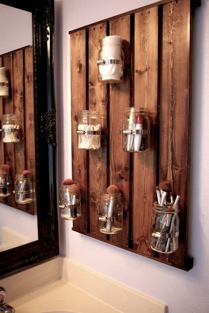 Mason Jar Storage There is nothing more rustic than some mason jars! This stunning mason jar storage organizer is perfect for your bathroom, especially if you are lacking in the storage department. All your friends are going to wish they had one too! thesawguy.com