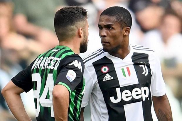 3a16067f577 got off lightly. Juventus winger Douglas Costa handed four match ban  following spit shame
