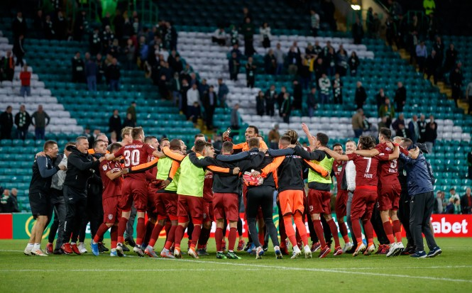 Cluj's players celebrate their win over Celtic