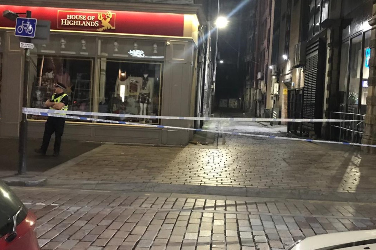 Glasgow cops seal off city centre street after serious assault leaves man in hospital