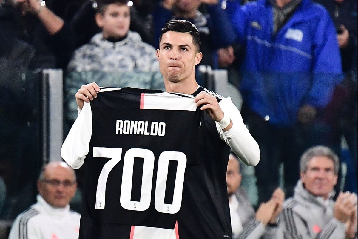 Cristiano Ronaldo handed commemorative shirt after scoring 700th career goal – and doesn't take long to make i