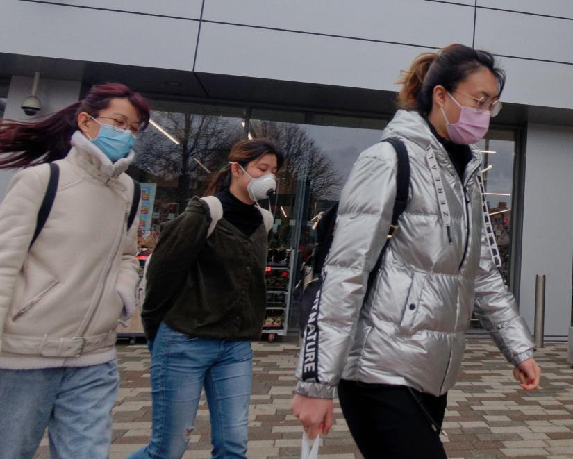 Students in Glasgow's West End wear masks during the virus outbreak