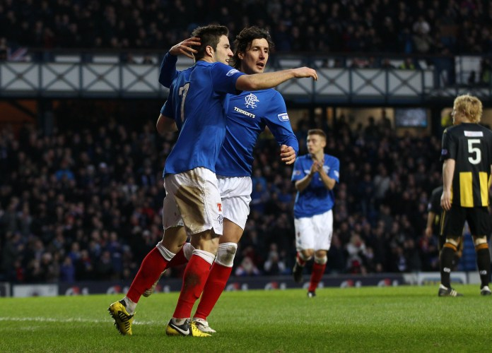 Spaniard celebrates a goal with Andy Little