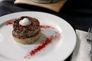 Seared Rabbit Rillettes with Rosemary Polenta & Wine Crème Sauc