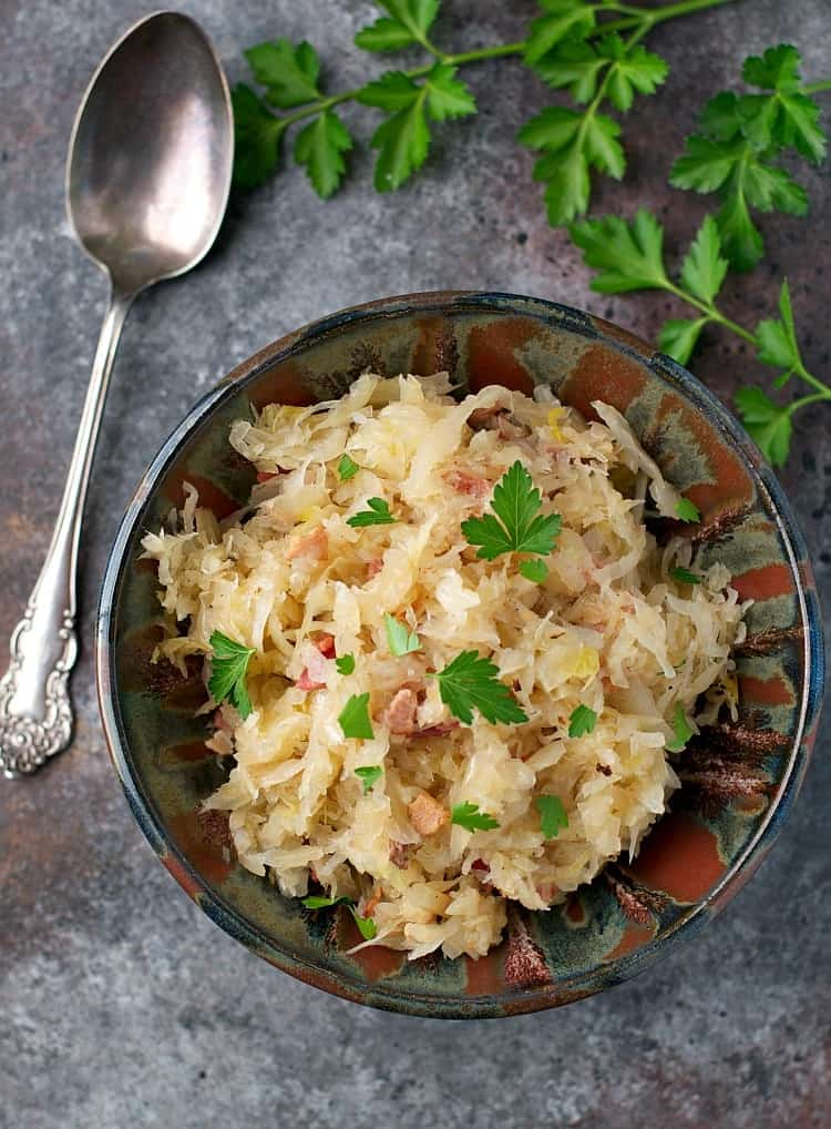 You only need 3 ingredients and 15 minutes to make my Grandma's Easy Sauerkraut with Crispy Bacon! It's a family favorite side dish that's perfect for the holidays!