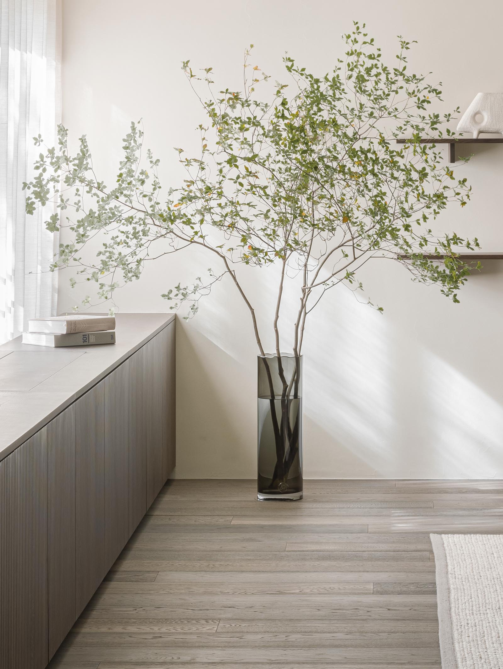 Large foliage display in a minimalist Japandi-style apartment in Tokyo | These Four Walls blog