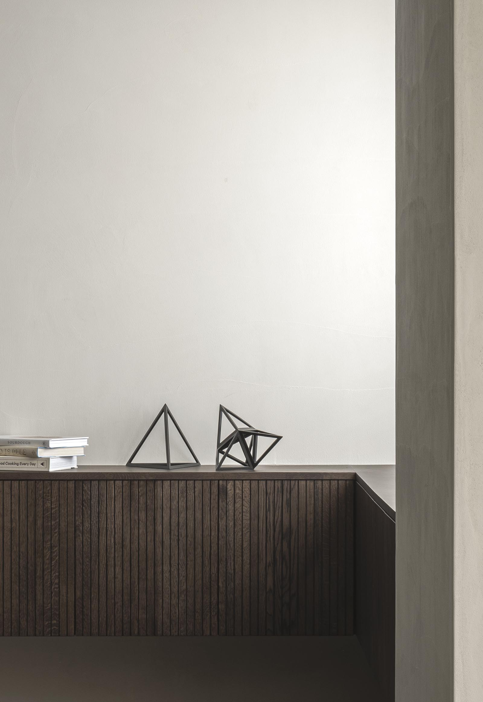 Bespoke wooden cabinetry in dark, earthy tones from Japandi design collaboration Karimoku Case Study | These Four Walls blog