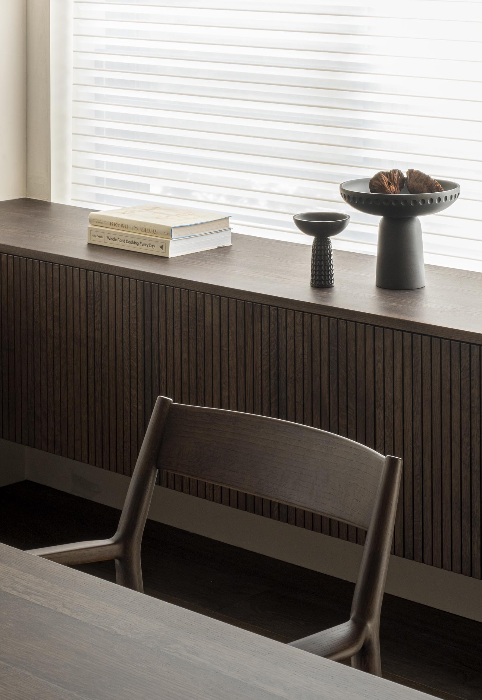 Bespoke wooden cabinetry in dark, earthy tones from Japandi design collaboration Karimoku Case Study | Home tour - soft minimalism & dark, earthy tones in Tokyo | These Four Walls blog