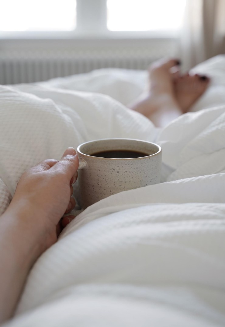 Cosy coffee in bed with temperature-control bedding from The Fine Bedding Company | These Four Walls blog