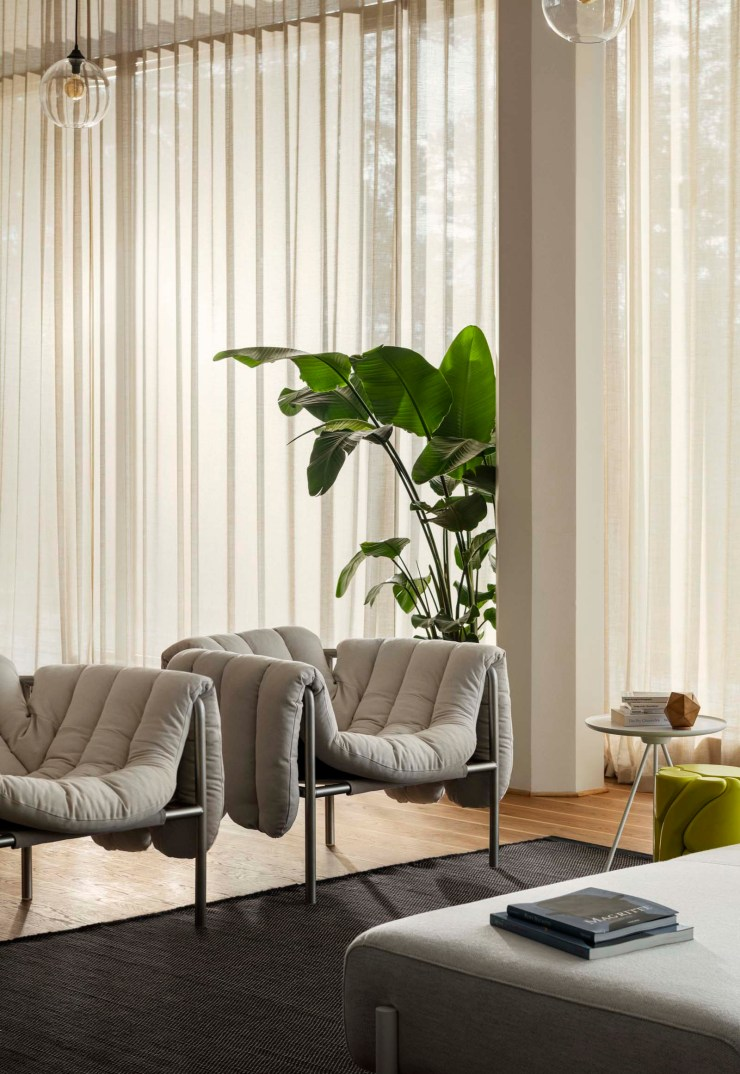 Contemporary beige living room with a pair of Hem's 'Puffy' lounge chairs | The design classics of the future | These Four Walls blog