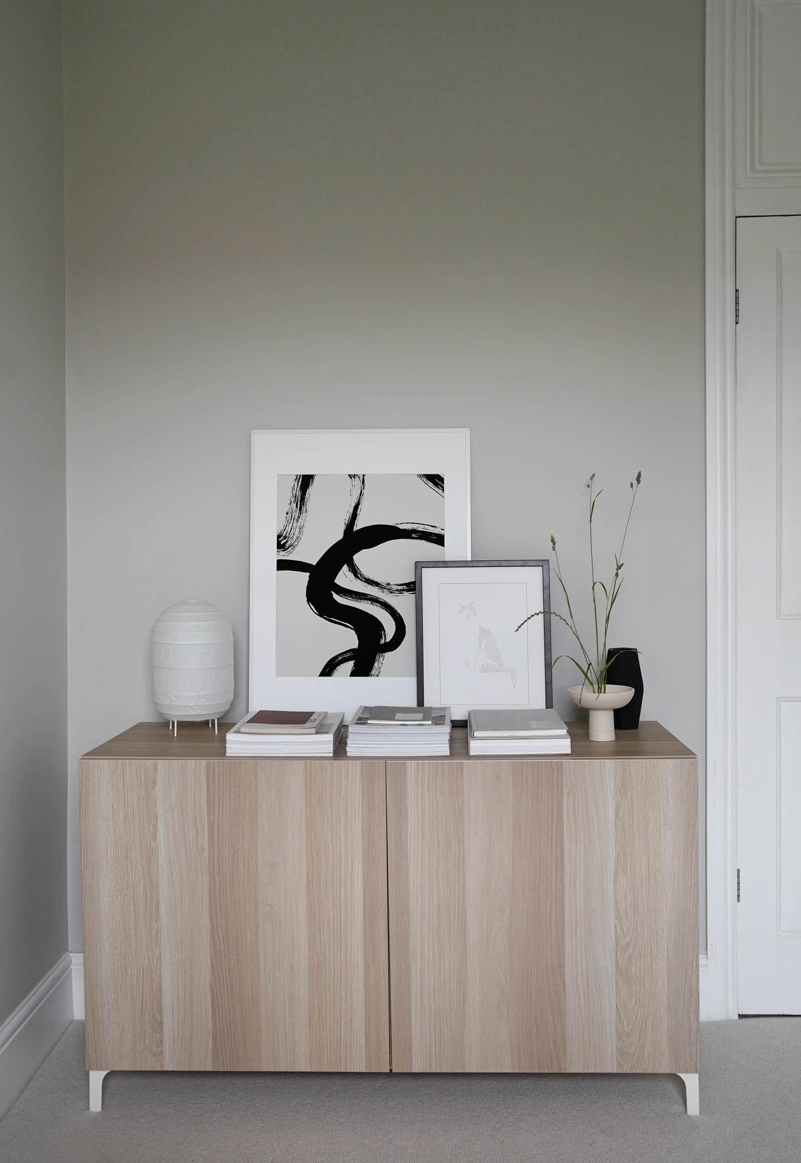 IKEA's oak BESTÅ storage cabinet, abstract artwork, Japandi-style Ikebana arrangement and soft grey walls in a minimalist home office | These Four Walls blog