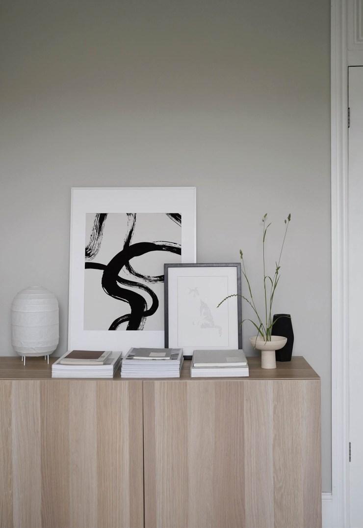 IKEA's oak BESTÅ storage cabinet, abstract artwork, Japandi-style Ikebana arrangement and soft grey walls in a minimalist home office   These Four Walls blog