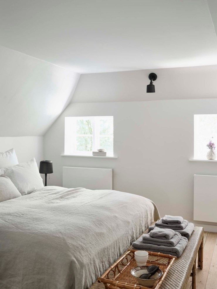 Minimalist white bedroom at the Vipp Farmhouse - a rustic-contemporary holiday cottage in the Danish countryside   These Four Walls blog