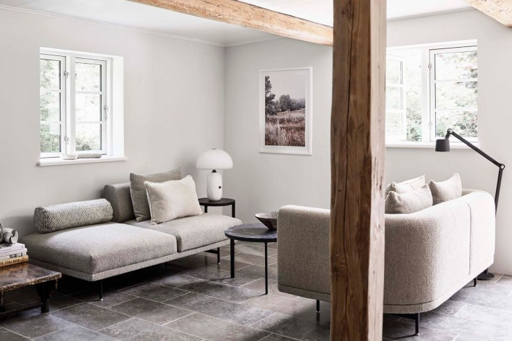 Rustic-minimalist living room in white, grey and beige at the Vipp Farmhouse - a Scandinavian holiday cottage deep in the Danish countryside   These Four Walls blog