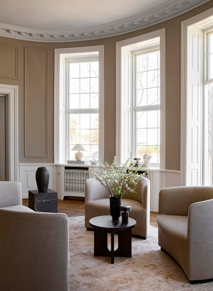 Beige living room with panelled walls, marble plinth and curved boucle chairs   The autumn-winter 2021 collection from Menu   These Four Walls blog
