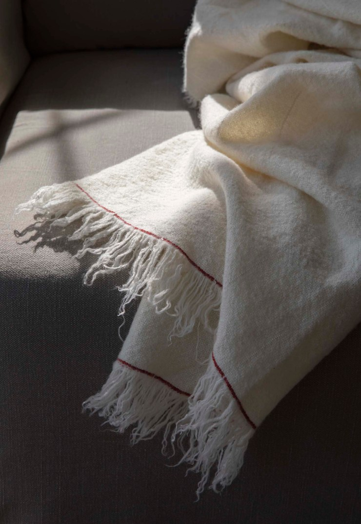 Soft beige woollen blanket from Danish design brand Menu's new home textile collection   These Four Walls blog