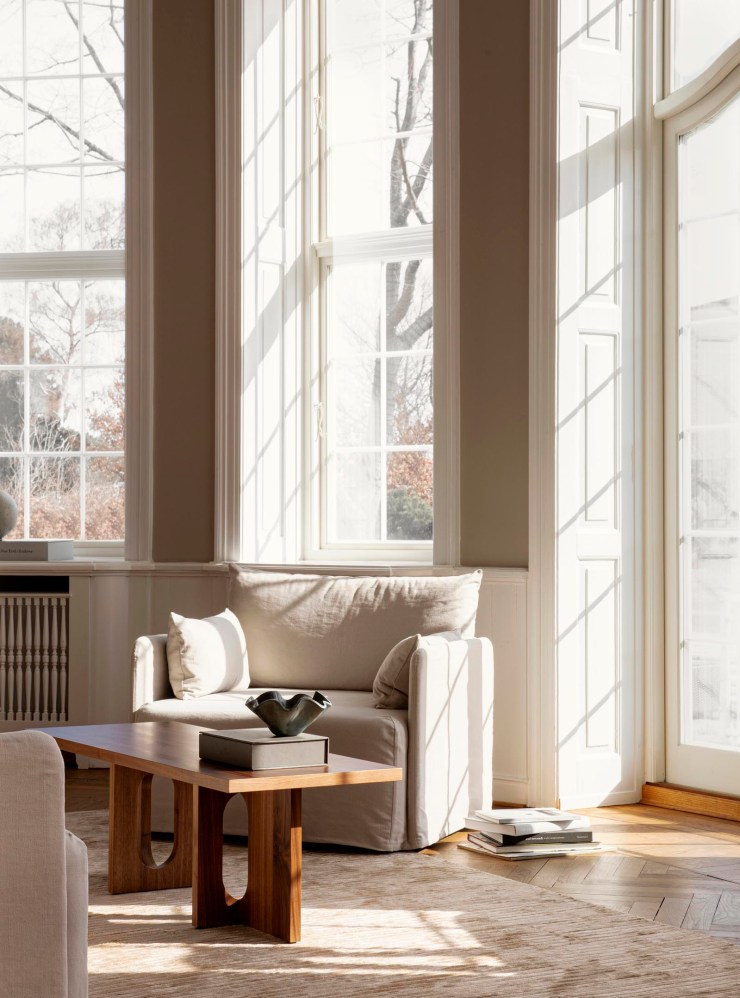 Minimalist living room with wooden coffee table, warm beige walls, period features and loose-covered linen sofa   The autumn-winter 2021 collection from Menu   These Four Walls blog