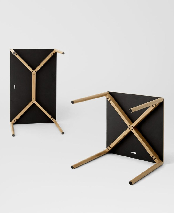 The minimalist 'Cross' table from TAKT, here with a black laminate top | These Four Walls blog