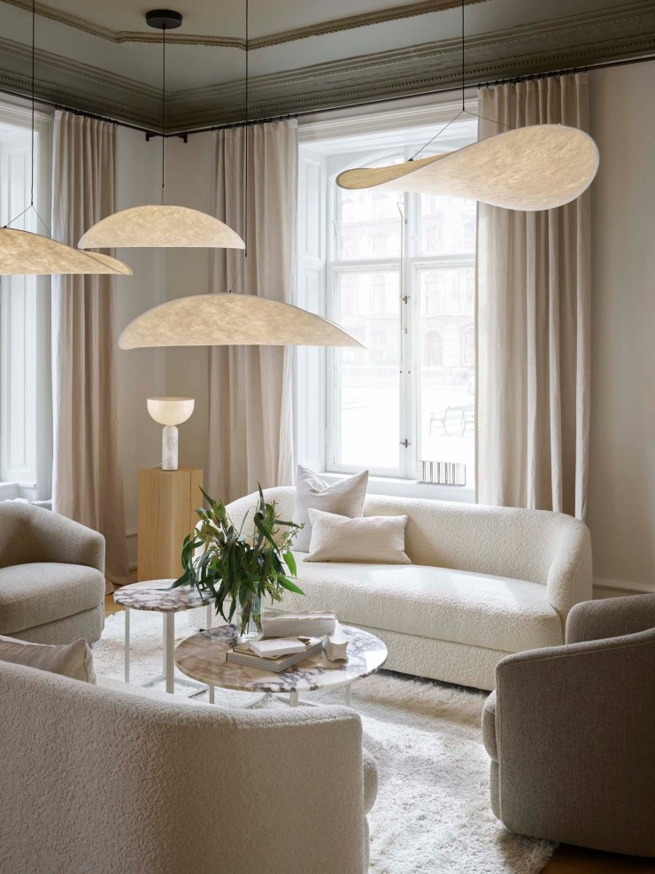 A light beige & white showroom makeover for New Works