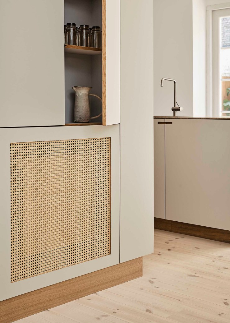 Minimalist beige kitchen with laminate doors, rattan radiator cover and hidden storage   These Four Walls blog