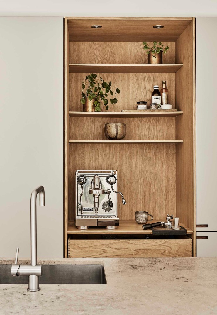 A warm, minimalist kitchen in beige and oak, with open niche, coffee bar and display shelves   These Four Walls blog