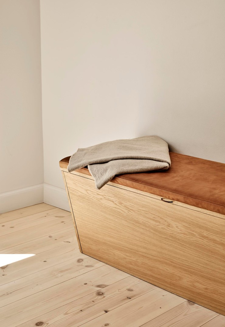 Built-in bench seat with hidden storage and tan suede cushion   These Four Walls blog