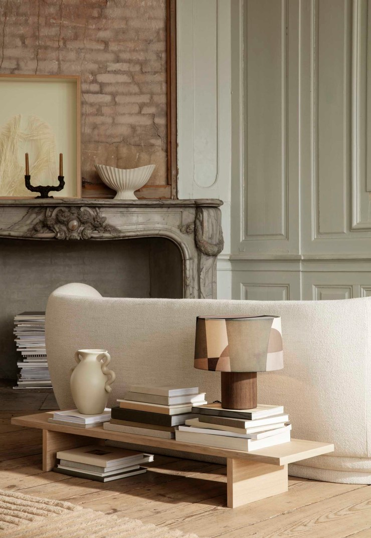 Soft green and beige living room with panelled walls, curved sofa, minimalist oak table and earthy neutral tones | The autumn-winter 2021 collection from Ferm Living | These Four Walls blog