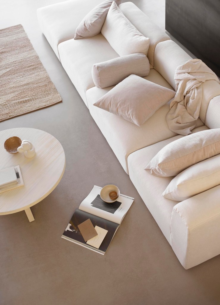 Contemporary Nordic living room with beige sofa, earthy tones and jute rug | Sot minimalism from Tine K Home's latest collection | These Four Walls blog