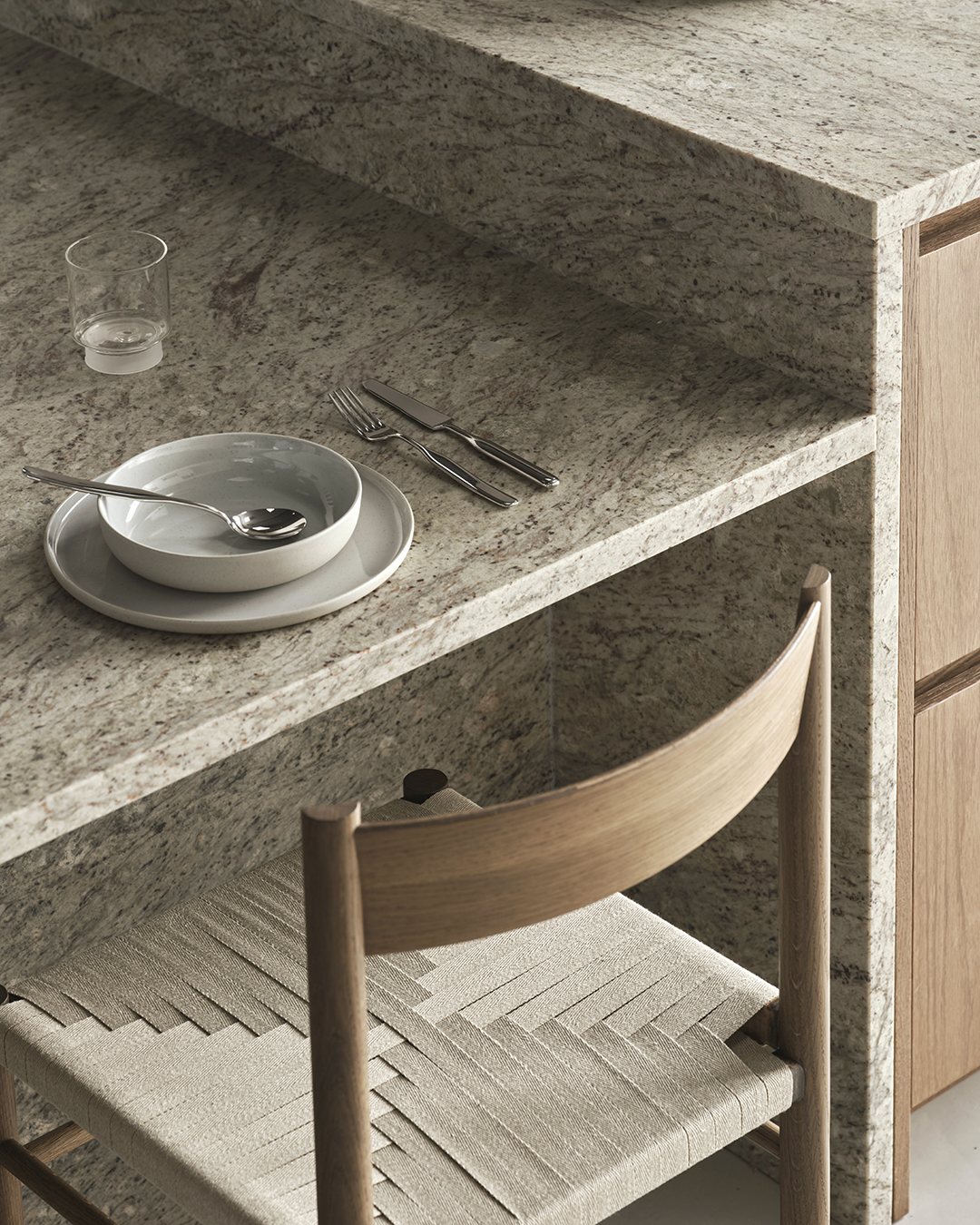 Split-level kitchen island unit with marble worktop and integrated dining area | Eight inspiring kitchen ideas from Nordiska Kök's new showroom | These Four Walls blog