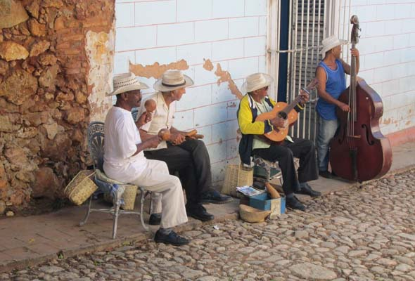 """""""Son"""" musicians play on a cobblestone sidewalk in the town of Trinidad. (Photo by Mark Medicoff)"""