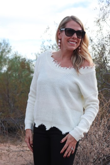 I love the cream color of this distressed sweater