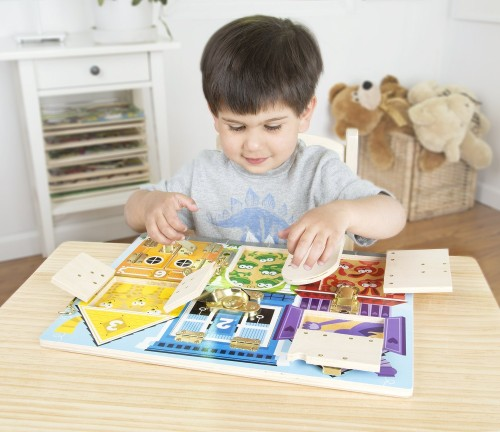 Child playing with Latches Board - Lots of fine motor fun!